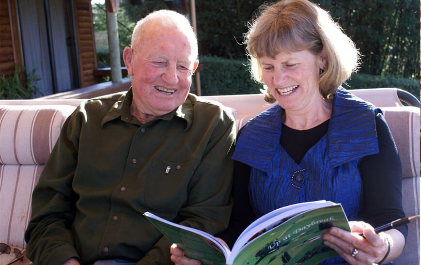 David Wilton sharing his book with daughter Heather.